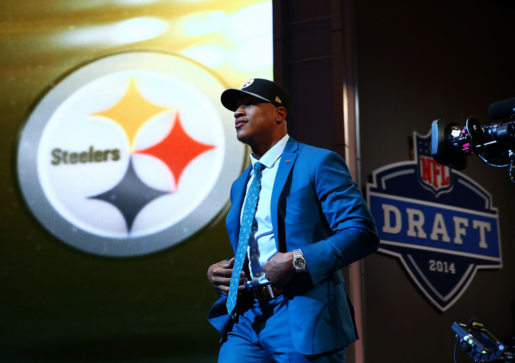 . Ryan Shazier of the Ohio State Buckeyes takes the stage after he was picked #15 overall by the Pittsburgh Steelers during the first round of the 2014 NFL Draft at Radio City Music Hall on May 8, 2014 in New York City.  (Photo by Elsa/Getty Images)