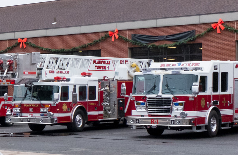120716 Wesley Bunnell | Staff Fire trucks sit outside of the Plainville Fire Department.