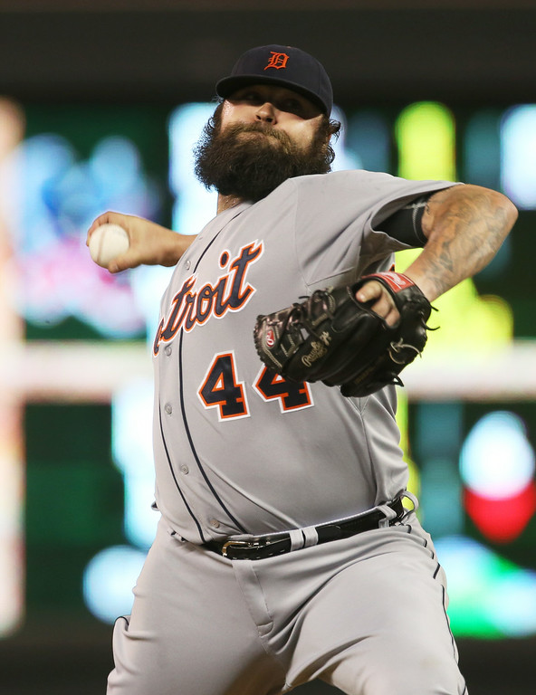 . Detroit Tigers pitcher Joba Chamberlain throws in the seventh inning of a baseball game against the Minnesota Twins, Friday, Aug. 22, 2014, in Minneapolis. The Twins won 20-6. (AP Photo/Jim Mone)