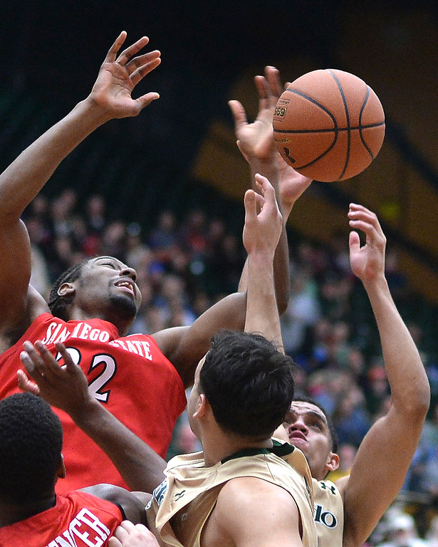 . San Diego State forward Josh Davis (22) blocked a shot by Rams\' guard Daniel Bejarano (2) in the second half.  Photo By Karl Gehring/The Denver Post