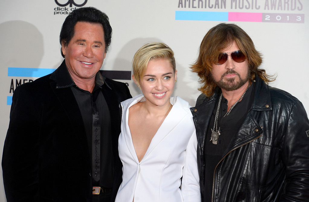 . Wayne  Newton , Miley Cyrus and  Billy Ray Cyrus arrives to the American Music Awards  at the Nokia Theatre in Los Angeles, California on Sunday November 24, 2013 (Photo by Andy Holzman / Los Angeles Daily News)