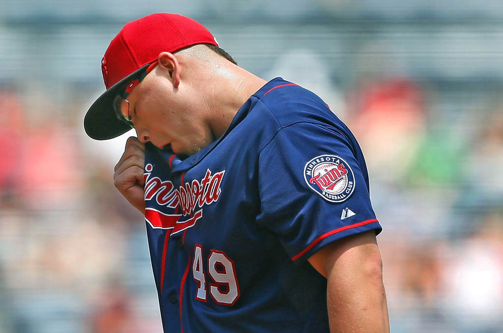 . Twins starter Vance Worley wipes sweat from his face in the second inning against the Braves.  (Photo by Kevin C. Cox/Getty Images)