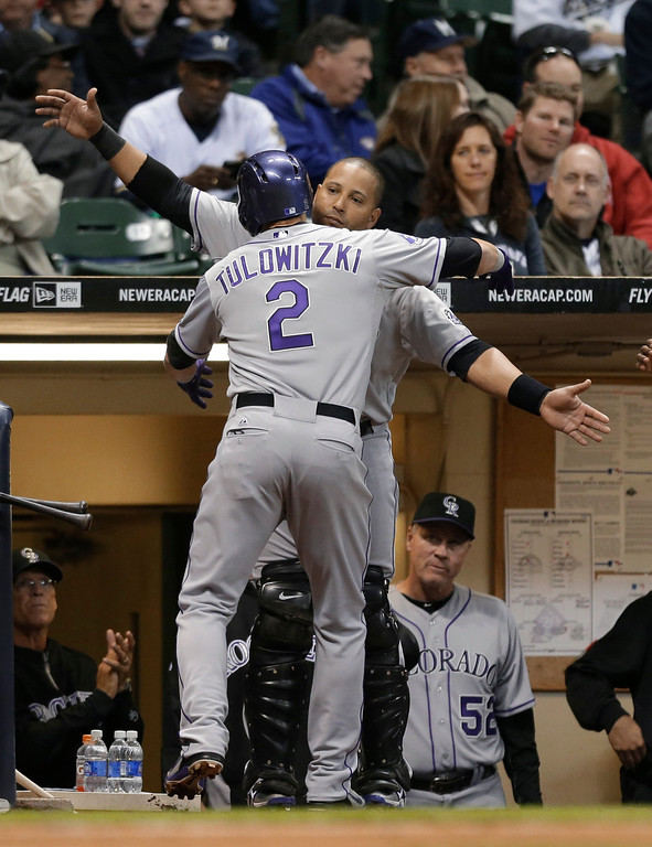 . Colorado Rockies\' Troy Tulowitzki (2) gets a hug from Yorvit Torrealba after Tulowitzki\'s home run against the Milwaukee Brewers during the third inning of a baseball game Tuesday, April 2, 2013, in Milwaukee. (AP Photo/Jeffrey Phelps)