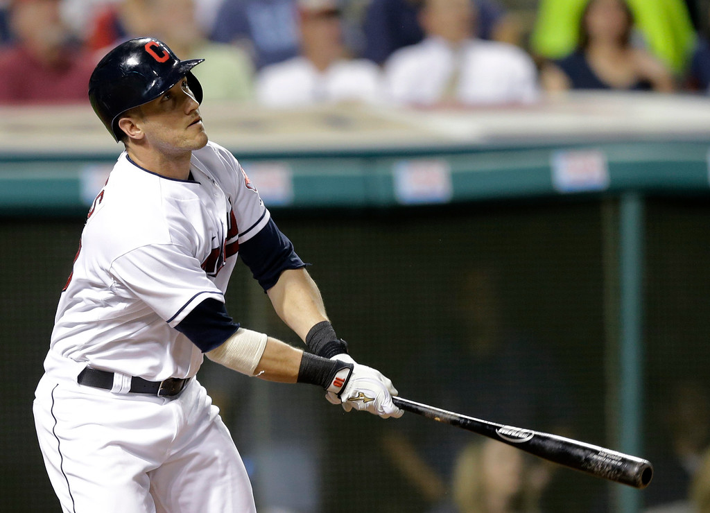 . Cleveland Indians\' Yan Gomes watches his sacrifice fly off Detroit Tigers starting pitcher Max Scherzer in the fourth inning of a baseball game, Thursday, Sept. 4, 2014, in Cleveland. (AP Photo/Tony Dejak)