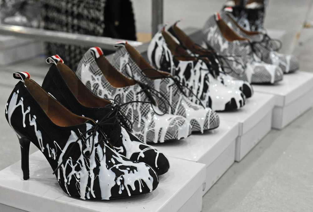 Description of . Shoes to be worn by models are displayed backstage before the showing of the Thom Browne Fall 2013 collection during Fashion Week, Monday, Feb. 11, 2013, in New York. (AP Photo/Louis Lanzano)