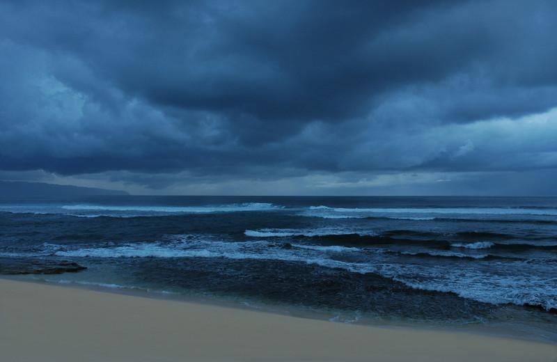 Dark Blue Cloudy Sky over a dark blue ocean at Sunset  North Shore of O'ahu, Hawai'i