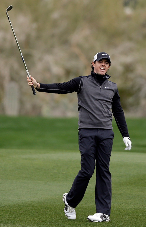 . Northern Ireland\'s Rory McIlroy reacts after a shot on the 10th fairway in the first round against Shane Lowry, of Ireland, during the Match Play Championship golf tournament, Thursday, Feb. 21, 2013, in Marana, Ariz. (AP Photo/Ted S. Warren)