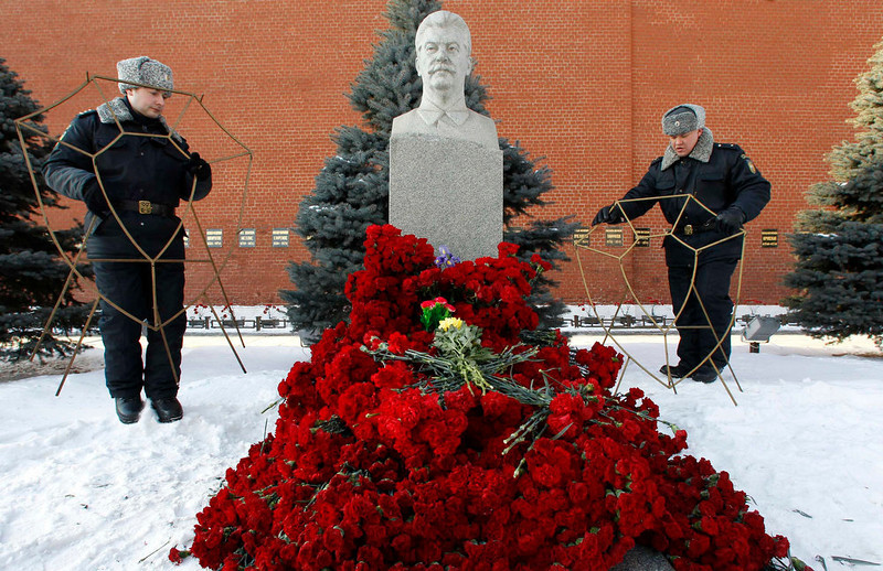 . Members of Russia\'s Federal Security Service place stands for wreaths at the grave of the late Soviet leader Josef Stalin before a ceremony to mark the 60th anniversary of his death in Red Square in central Moscow on March 5, 2013. REUTERS/Sergei Karpukhin