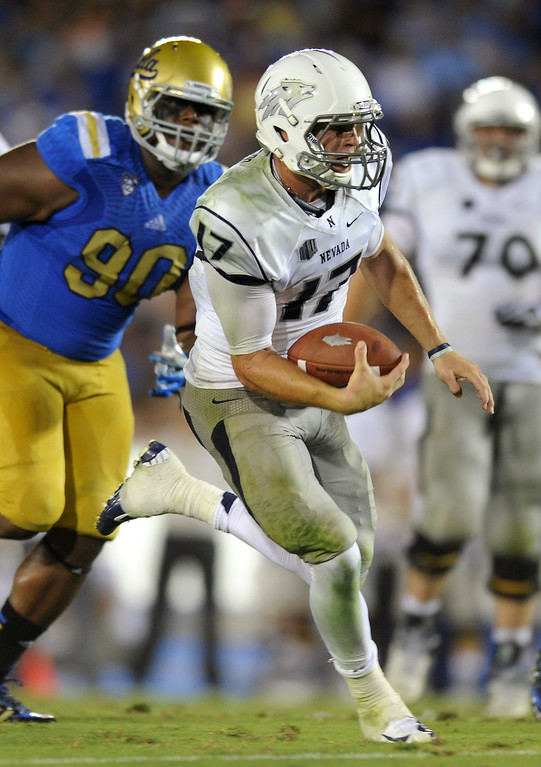 . Nevada QB Cody Fajardo runs for an 18-yard touchdown run in the fourth quarter against UCLA, Saturday, August 31, 2013, at the Rose Bowl. (Michael Owen Baker/L.A. Daily News)