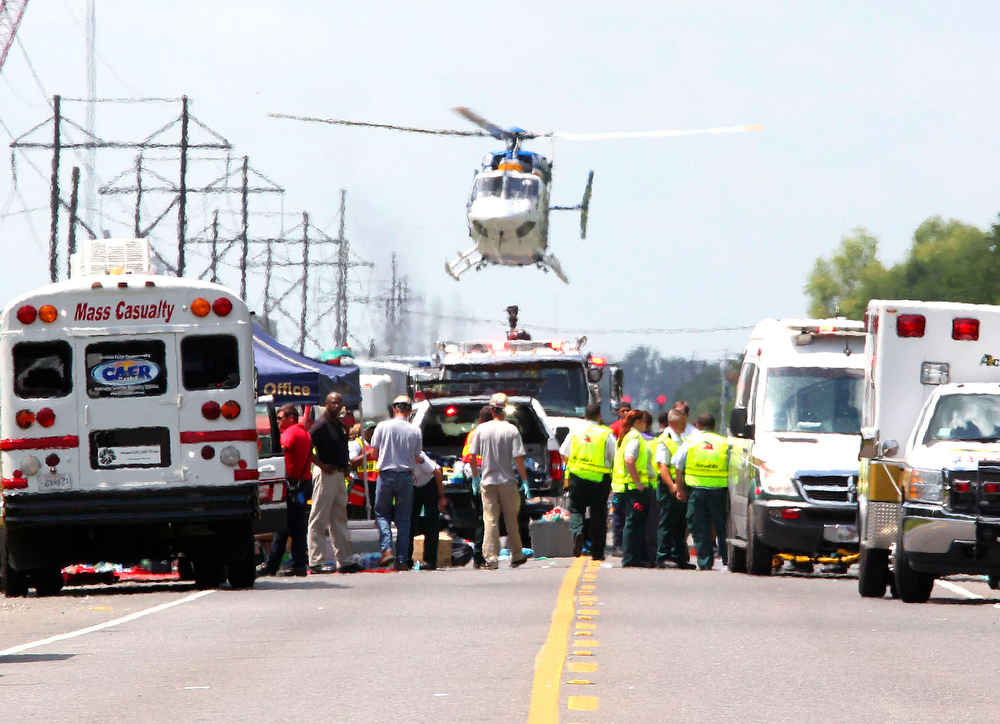 . A Medevac helicopter lands at a triage center set up on highway LA 3115 near the Williams Olefins chemical plant, after an explosion and fire there, in Geismar, Louisiana June 13, 2013. An explosion and fire tore through the chemical plant in Geismar, Louisiana, on Thursday, injuring 33 people and leading authorities to order people within two miles (3 km) to remain indoors. REUTERS/Jonathan Bachman