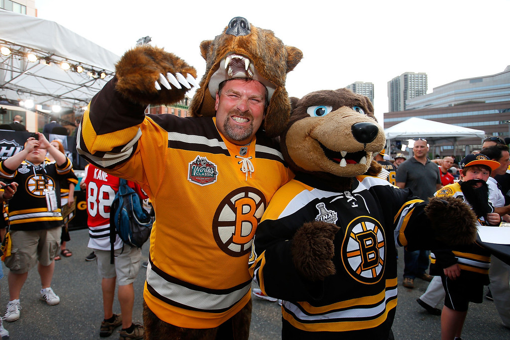 . Fans of the Boston Bruins pose for a photo outside of the arena prior to the Bruins hosting the Chicago Blackhawks in Game Six of the 2013 NHL Stanley Cup Final at TD Garden on June 24, 2013 in Boston, Massachusetts.  (Photo by Jim Rogash/Getty Images)