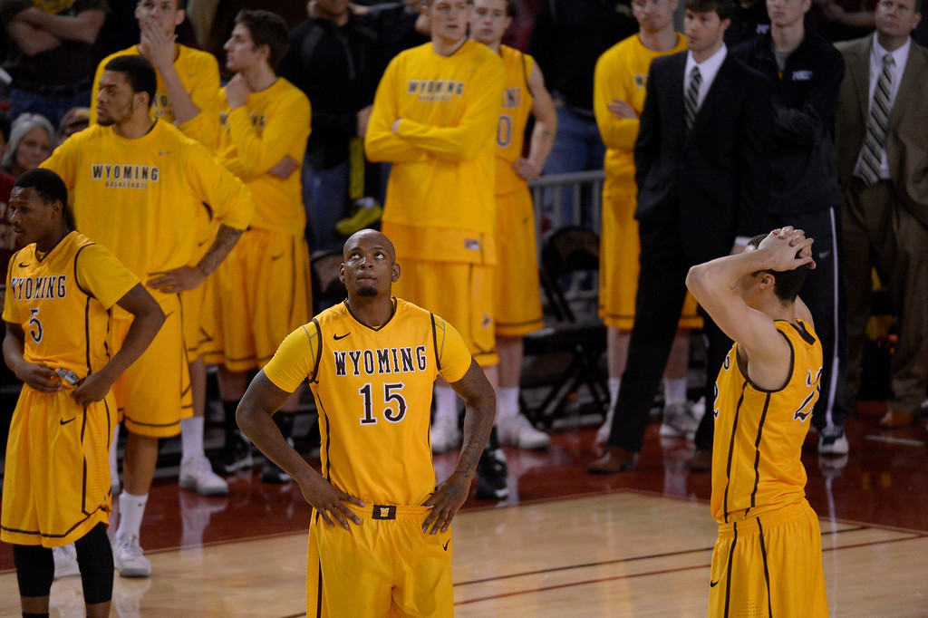 . Wyoming Cowboys guard Jerron Granberry (15) and Wyoming Cowboys forward Larry Nance Jr. (22) stand dejected after Denver Pioneers defeats them 64-61 December 15, 2013 Magness Arena. (Photo by John Leyba/The Denver Post)