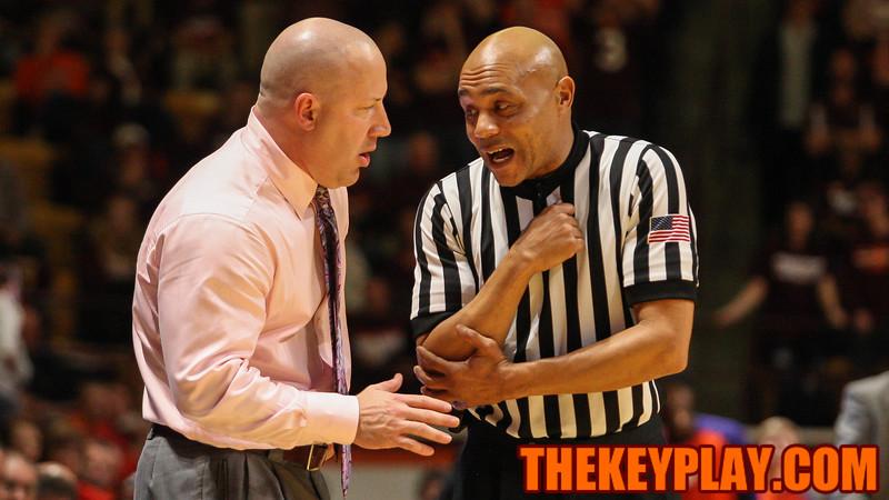 A referee explains a foul call to head coach Buzz Williams. (Mark Umansky/TheKeyPlay.com)