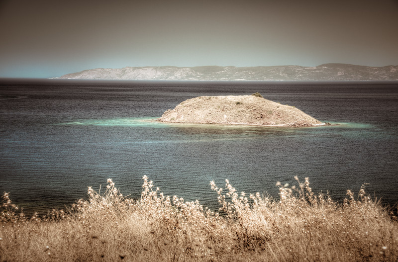 Island off Petra Beach, Lesvos, Greece. Turkish coast in the background.