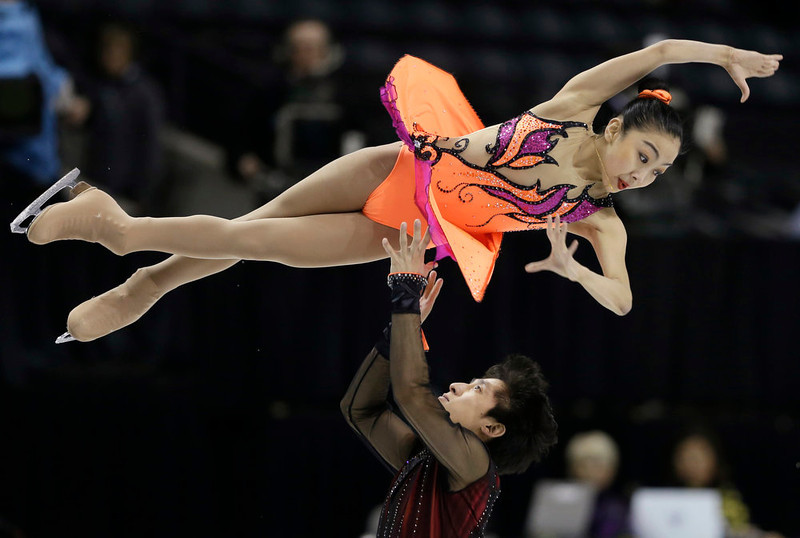 . Sui Wenjing and Han Cong, of China perform during the pairs short program at the World Figure Skating Championships Wednesday, March 13, 2013, in London, Ontario. (AP Photo/Darron Cummings)