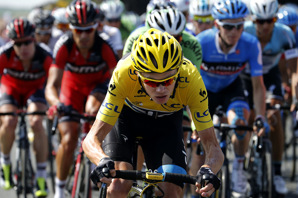 . Overall leader\'s yellow jersey Britain\'s Christopher Froome rides in the pack during the 173 km thirteenth stage of the 100th edition of the Tour de France cycling race on July 12, 2013 between Tours and Saint-Amand-Montrond, central France. JOEL SAGET/AFP/Getty Images