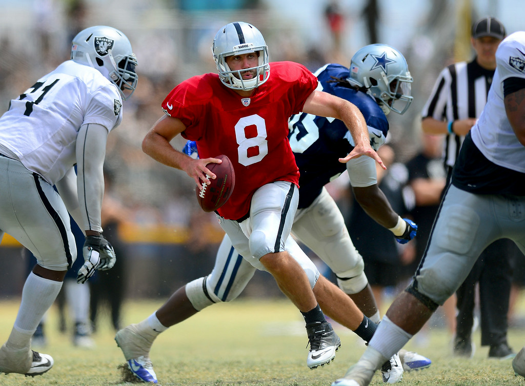 . Raider QB Matt Schaub scrambles at the Cowboys-Raiders practice in Oxnard, Wednesday, August 13, 2014. (Photo by Michael Owen Baker/Los Angeles Daily News)