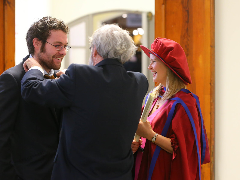 "Waterford Institute Of Technology Conferring. Pictured at WIT Waterford Institute Of Technology Conferring is on right Jill O'Mahoney, Waterford, who was conferred a Doctor of Philosophy watches as her dad John ""tidies up"" her boyfriend Edward Ryan . Picture: Patrick Browne"