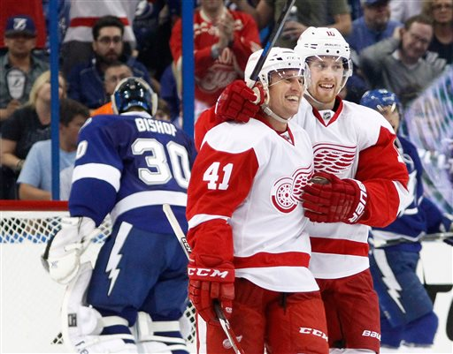 . Detroit Red Wings right wing Luke Glendening (41) smiles next to center Joakim Andersson after scoring against Tampa Bay Lightning goalie Ben Bishop, left rear, during the third period in Game 1 of an NHL hockey first-round playoff series, Thursday, Aprill 16, 2015, in Tampa, Fla. The Red Wings won 3-2. (Dirk Shadd/Tampa Bay Times via AP)