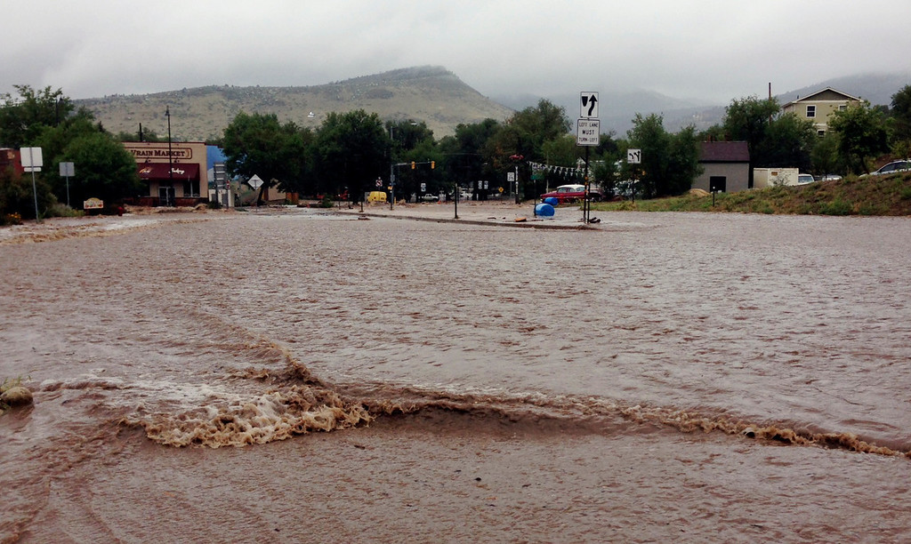 . This image provided by Jason Stillman, shows flooding in Lyons Colo., Thursday Sept. 12, 2013. Boulder County Sheriff Joe Pelle said the town of Lyons was completely cut off because of flooded roads (AP Photo/Jason Stillman)