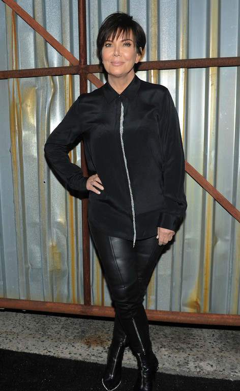. Kris Jenner poses for a photo before the Alexander Wang Spring 2018 collection is shown in the Bushwick neighborhood of Brooklyn during New York Fashion Week, Saturday, Sept. 9, 2017. (AP Photo/Diane Bondareff)