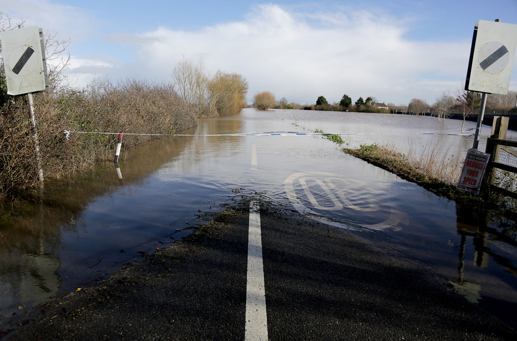 . Flood water covers the main A361 road as it enters the village of East Lyng on February 13, 2014 in Somerset, England. (Photo by Matt Cardy/Getty Images)
