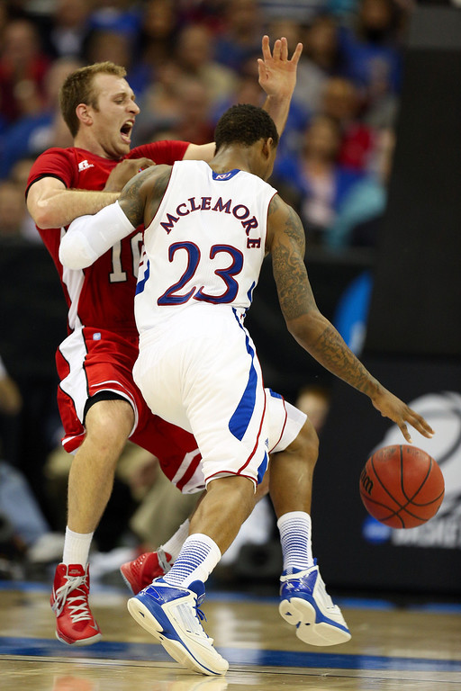 . KANSAS CITY, MO - MARCH 22: Ben McLemore #23 of the Kansas Jayhawks drives against Caden Dickerson #10 of the Western Kentucky Hilltoppers  in the second half during the second round of the 2013 NCAA Men\'s Basketball Tournament at the Sprint Center on March 22, 2013 in Kansas City, Missouri.  (Photo by Ed Zurga/Getty Images)