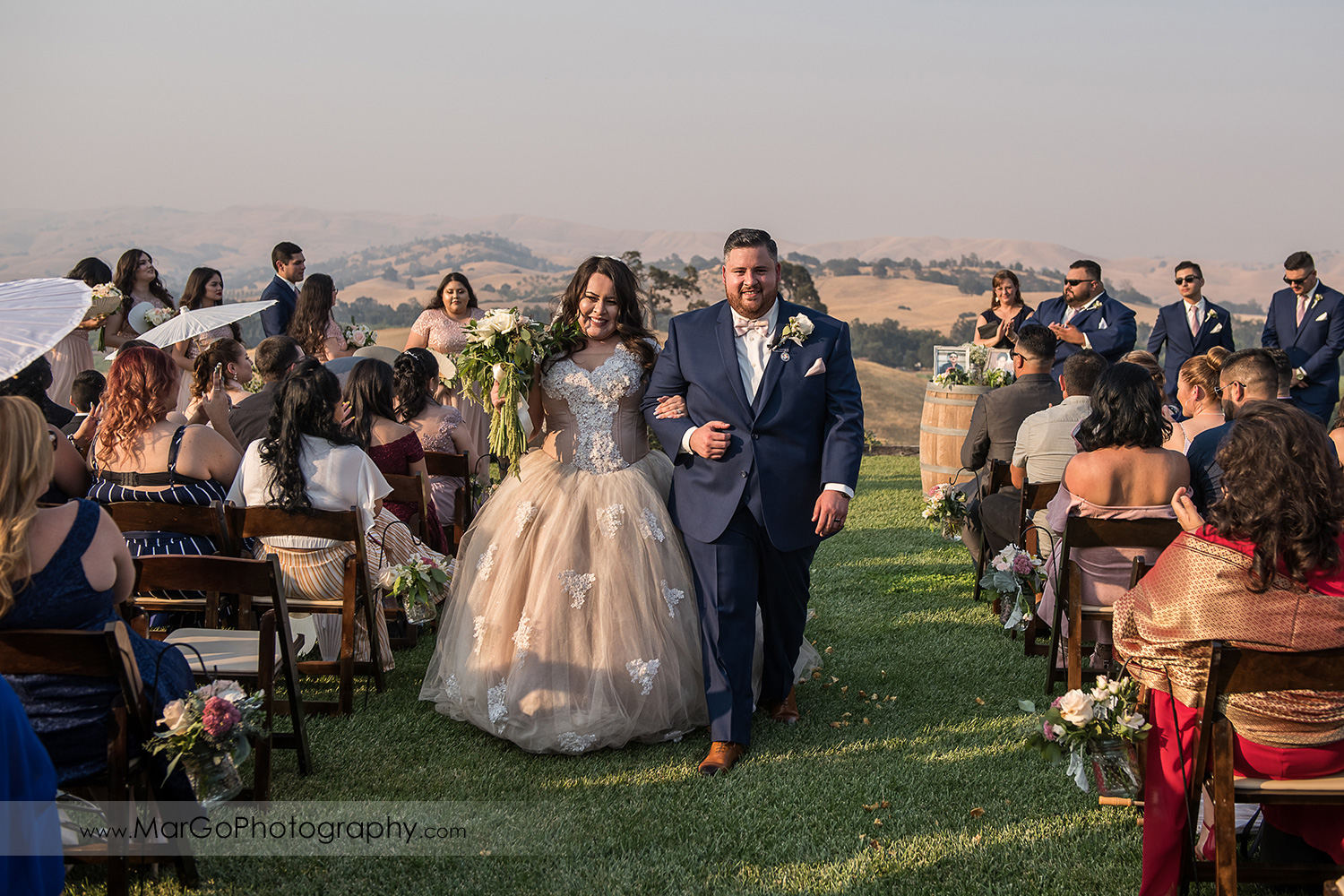bride and groomwalking down the aisle after wedding ceremony at Taber Ranch Vineyards