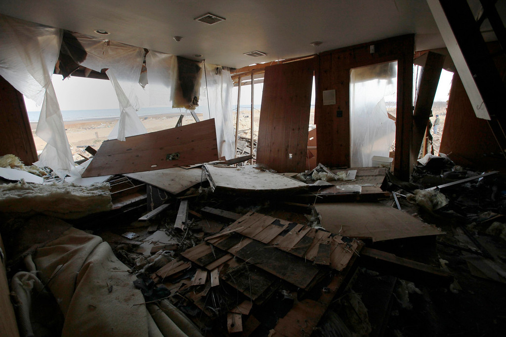 . A view of the living room of an ocean-front home destroyed by Superstorm Sandy, one month after the disaster, at the zone of Union Beach in New Jersey November 29, 2012. REUTERS/Eduardo Munoz.