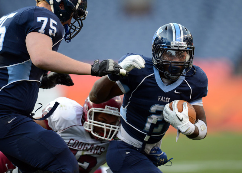 . Valor Christian RB Daryl Hawkins is rushing against the Cherokee Trail defense during the 1st half of the 5A State Championship game at Sports Authority Field at Mile High on Saturday in Denver, CO on December 1, 2012. Hyoung Chang, The Denver Post