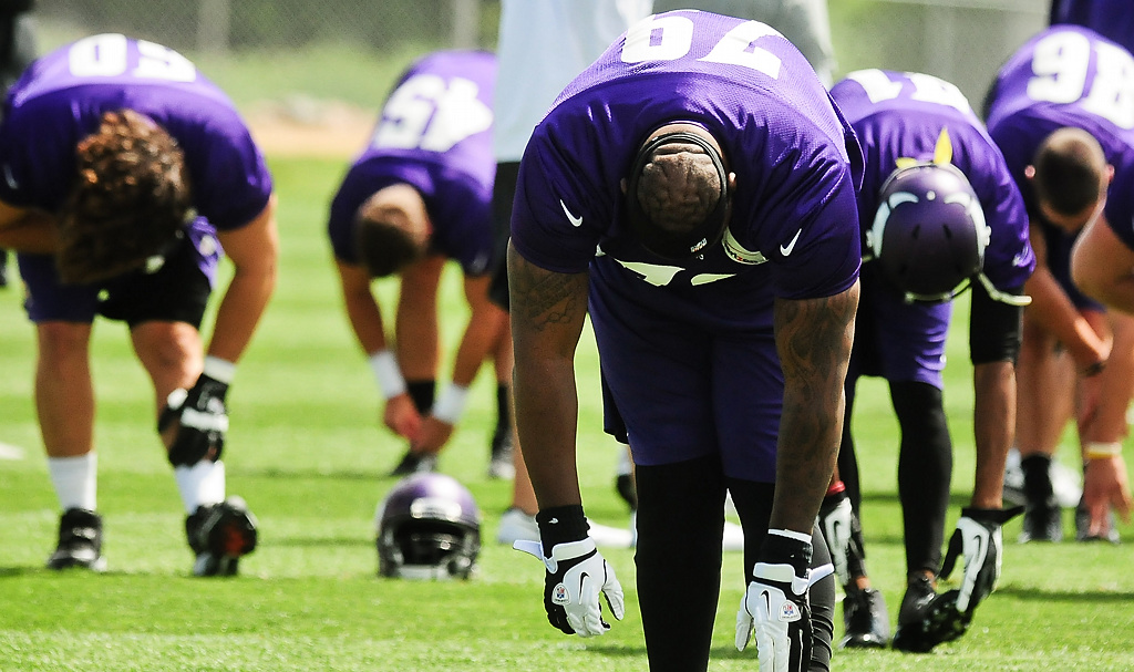 . Players stretch before practice at Vikings training camp in Mankato, Minn., on Friday, July 26, 2013. (Pioneer Press: Ben Garvin)