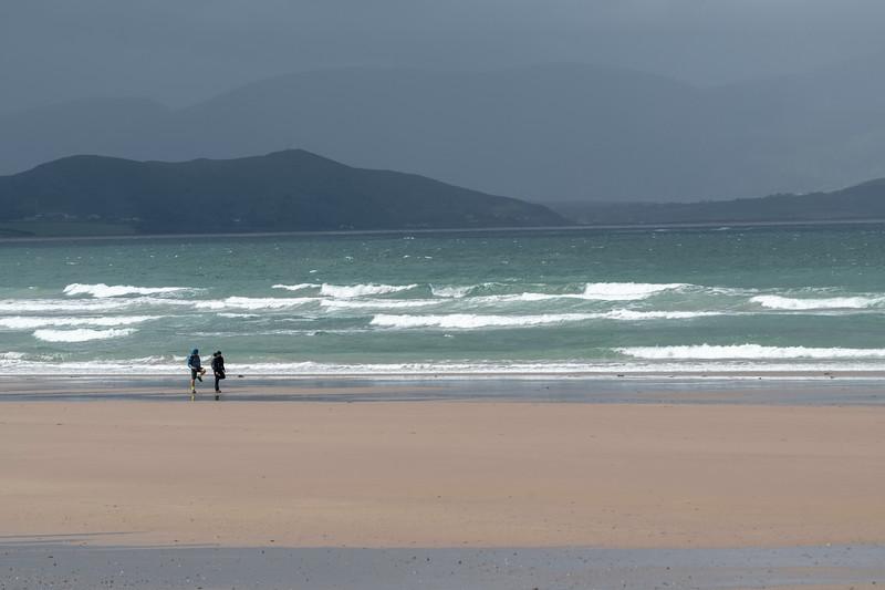 Hikers on beach of beach, Castlegregory, County Kerry, Ireland