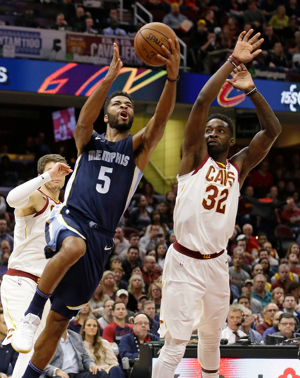 . Memphis Grizzlies\' Andrew Harrison (5) drives to the basket against Cleveland Cavaliers\' Jeff Green (32) in the second half of an NBA basketball game, Saturday, Dec. 2, 2017, in Cleveland. (AP Photo/Tony Dejak)