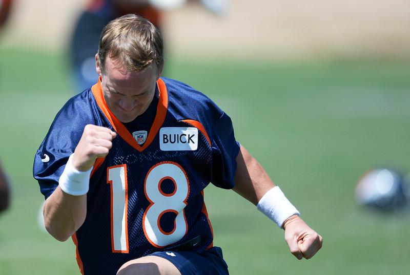 . Denver Broncos quarter back Peyton Manning (18) stretches during OTAs June 12, 2014 at Dove Valley. (Photo by John Leyba/The Denver Post)