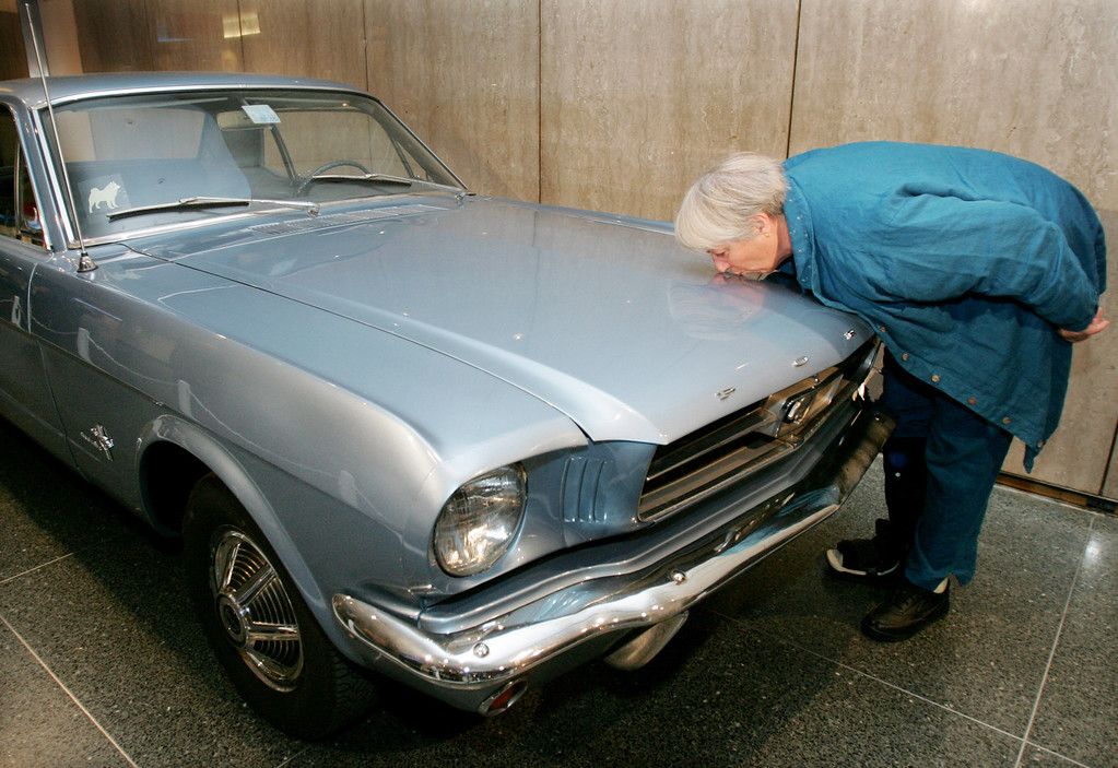 . Eleanor McMillan, a retired Smithsonian conservator, kisses her 1965 Ford Mustang goodbye, Wednesday, Dec. 8, 2004, after she donated it to the National Museum of American History in Washington. McMillain owned the Mustang for almost 40 years and was the original owner.     (AP Photo/Ron Edmonds)