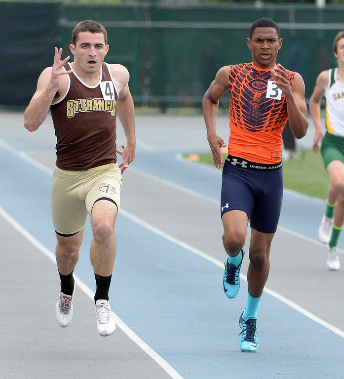. St. Francis\'s Ross Nierderhaus, left, along with Chaminade\'s Greg Campbell competes in the division 1 400 meters race during the CIF Southern Section track and final Championships at Cerritos College in Norwalk, Calif., Saturday, May 24, 2014.   (Keith Birmingham/Pasadena Star-News)