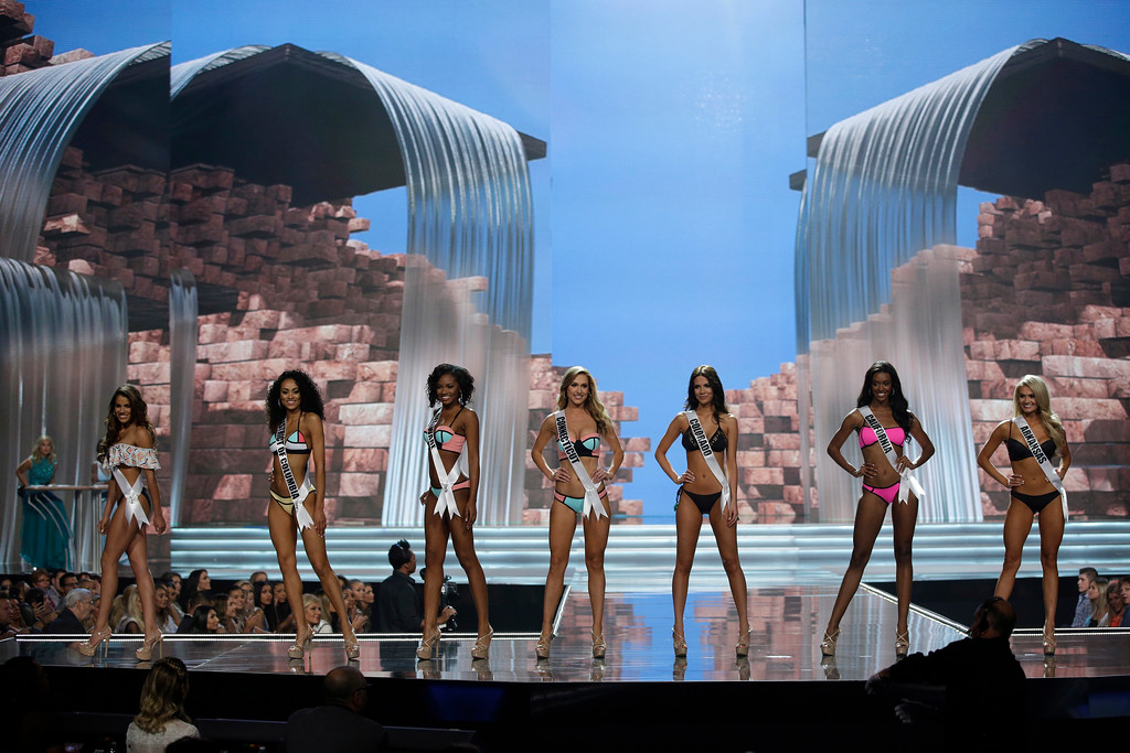 . CORRECTS NAME TO LITVINENKO ON SECOND REFERENCE In this May 11, 2017, photo, Miss Connecticut USA Olga Litvinenko, center, competes with others during a preliminary competition for Miss USA in Las Vegas. Litvinenko, who emigrated from Ukraine, speaks three languages and owns her own small business. Five of the contestants vying for the Miss USA title this year were born in other countries and now U.S. citizens. (AP Photo/John Locher)
