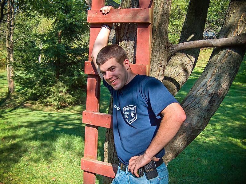 71 Caleb In HFD shirt in back yard-1.jpg