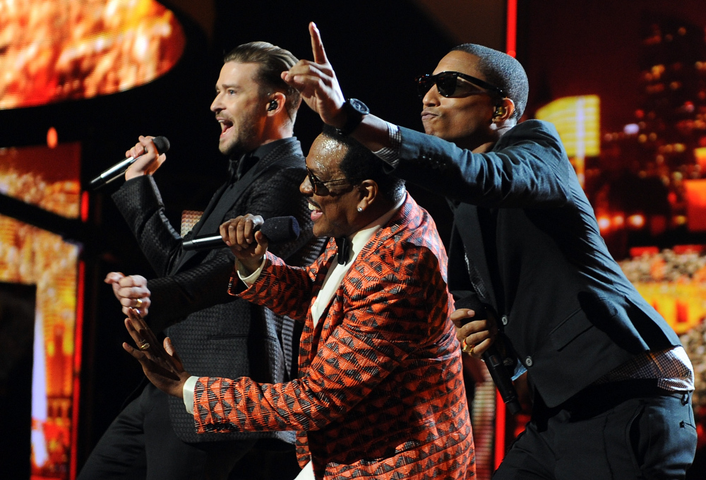 Description of . Singers Justin Timberlake, Charlie Wilson and Pharrell Williams perform onstage during the 2013 BET Awards at Nokia Theatre L.A. Live on June 30, 2013 in Los Angeles, California.  (Photo by Kevin Winter/Getty Images for BET)
