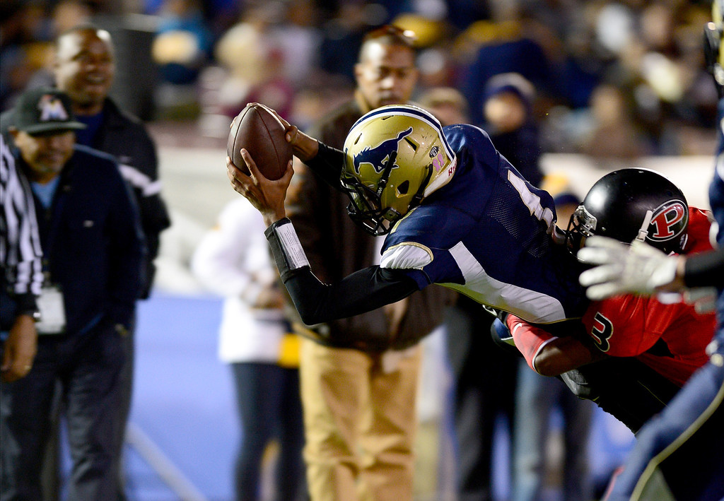 . Muir\'s quarterback Dejon Williams (1) makes the last touchdown of the game in the annual Turkey Tussle against Pasadena Friday night, November 8, 2013 at the Rose Bowl in Pasadena as they defeat Pasadena 32-21.(Photo by Sarah Reingewirtz/Pasadena Star-News)