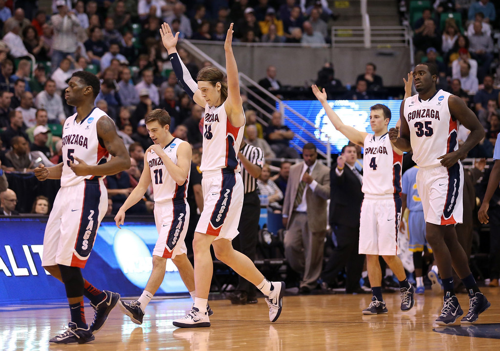 . Gary Bell, Jr. #5, David Stockton #11, Kelly Olynyk #13, Kevin Pangos #4 and Sam Dower #35 of the Gonzaga Bulldogs celebrate as they head to the bench late in the second half against the Southern University Jaguars during the second round of the 2013 NCAA Men\'s Basketball Tournament at EnergySolutions Arena on March 21, 2013 in Salt Lake City, Utah.  (Photo by Streeter Lecka/Getty Images)