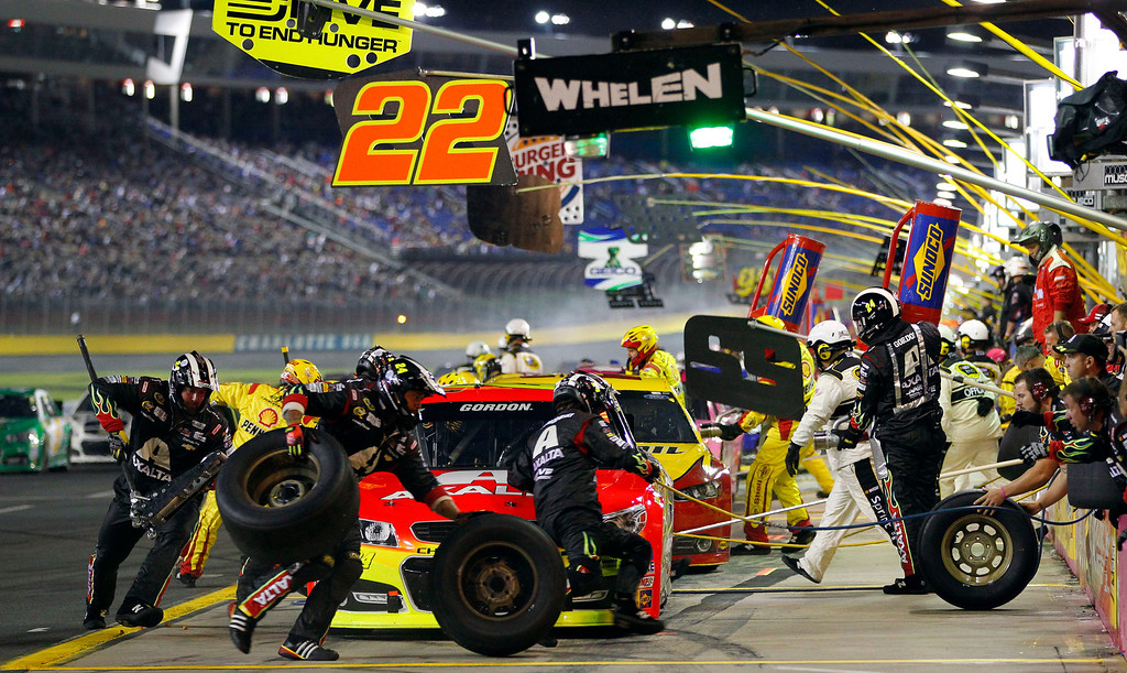 . Jeff Gordon (24) pits during the NASCAR Sprint Cup Series auto race at Charlotte Motor Speedway in Concord, N.C., Saturday, Oct. 12, 2013. (AP Photo/Terry Renna)