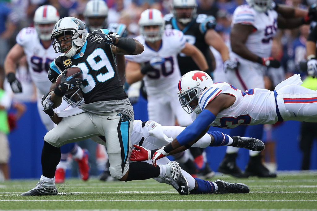. Steve Smith #89 of the Carolina Panthers is tackled during NFL game action by Aaron Williams #23 of the Buffalo Bills at Ralph Wilson Stadium on September 15, 2013 in Orchard Park, New York. (Photo by Tom Szczerbowski/Getty Images)