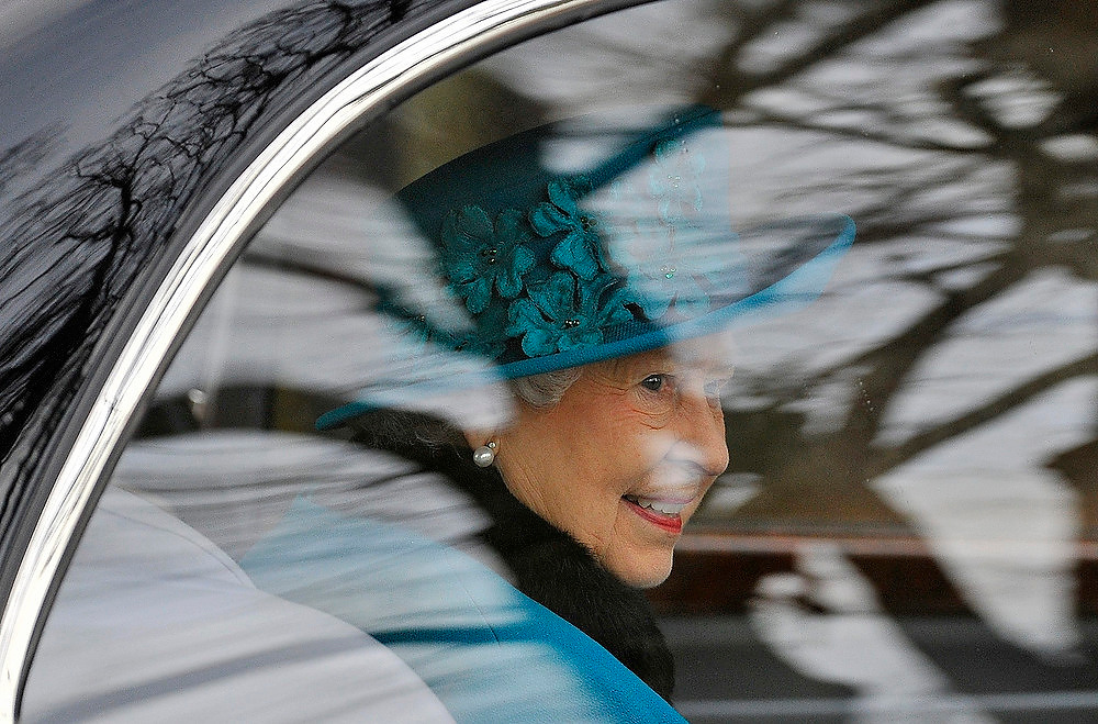 Description of . Britain's Queen Elizabeth leaves St. Mary's church after attending the annual Christmas service on the Royal Estate at Sandringham in Norfolk, eastern England December 25, 2012. REUTERS/Toby Melville