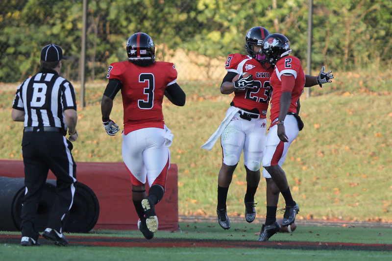Juanne Blount (23) and Richard Jules (2) celebrate after a touchdown