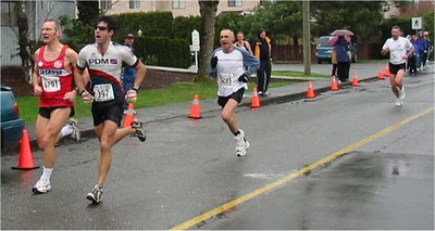 2003 Comox Valley Half Marathon - Dr. Bob Janicki battles to the wire