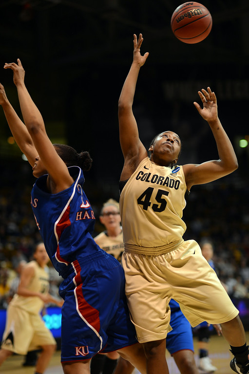 . BOULDER, CO. - MARCH 23: Kyleesha Weston of Colorado Buffaloes (45), right, and Charlicia Harper of Kansas Jayhawks (24) are fighting for the control of free ball during the first round of the 2013 NCAA women\'s Basketball Tournament at Coors Events Center. Boulder, Colorado. March 23, 2013. Kansas won 67-52. (Photo By Hyoung Chang/The Denver Post)