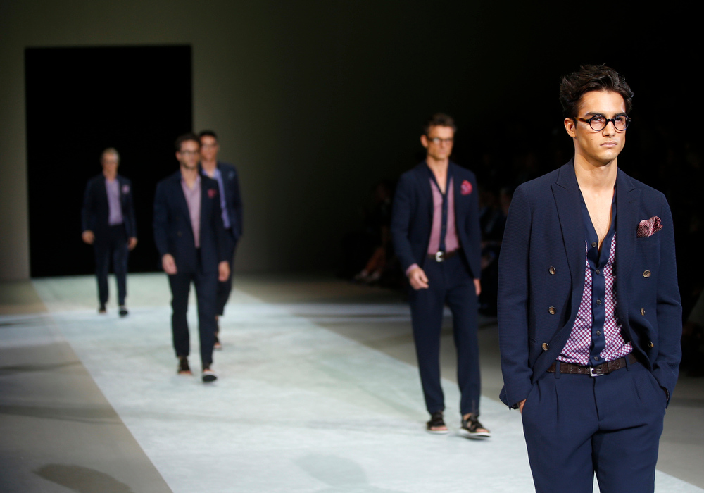 . Models wear creations for Giorgio Armani men\'s Spring-Summer 2015 collection, part of the Milan Fashion Week, unveiled in Milan, Italy, Tuesday, June 24, 2014. (AP Photo/Luca Bruno)
