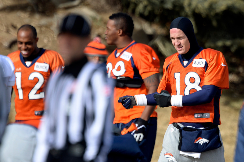 . Denver Broncos quarterback Peyton Manning (18) stretches before practice January 16, 2014 at Dove Valley. The Denver Broncos are preparing for their AFC Championship game against the New England Patriots at Sports Authority Field.  (Photo by John Leyba/The Denver Post)