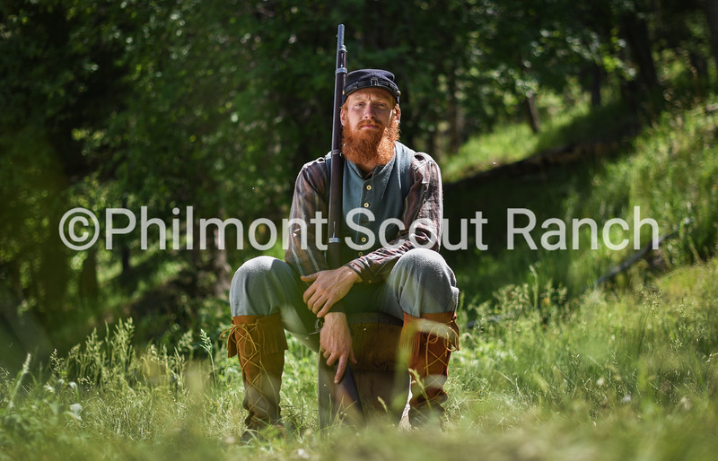 Derek Ford sits with his .58 caliber rifle at Black Mountain Camp on June 21, 2016. The camp features blacksmithing and allows crews to both load and fire a replica Civil War era blackpowder rifle. Gabriel Scarlett/Philnews.